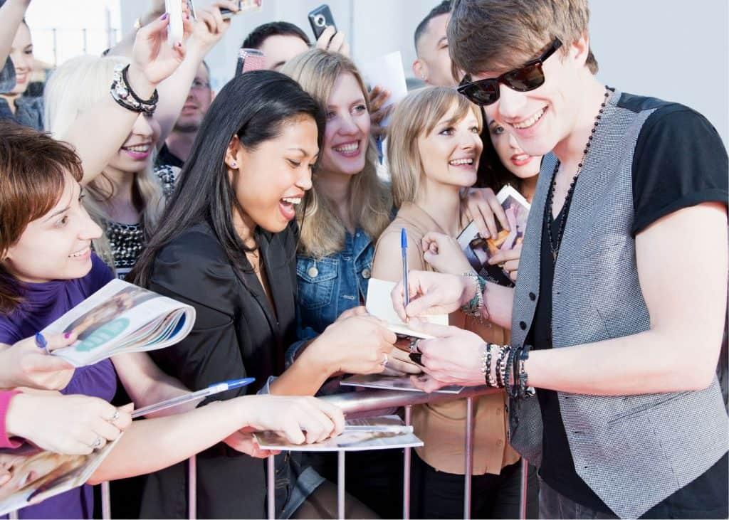 Celebrity signing autographs