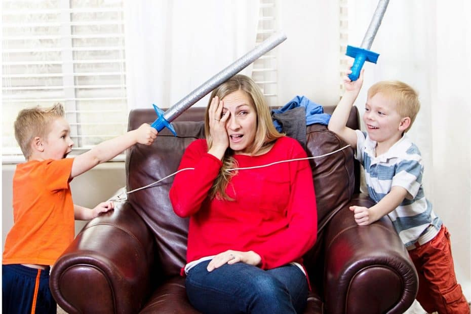 Mom with two boys playing